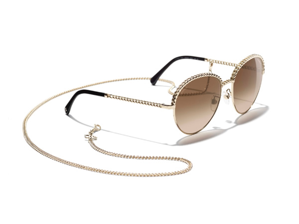 Pantos Sunglasses with gold frame, brown gradient lenses.