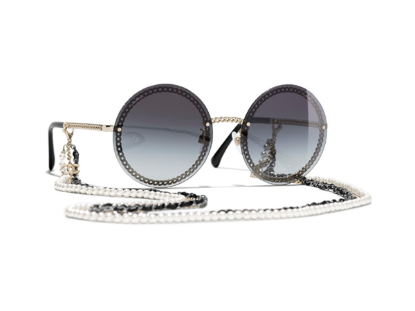 Round Sunglasses with gold frame, gray gradient lenses.